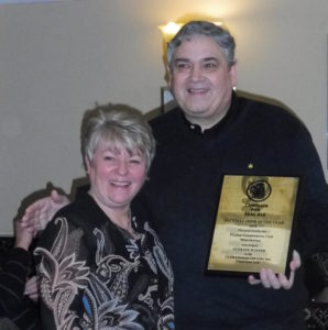 Club Stewards Nigel & Sharon with the award